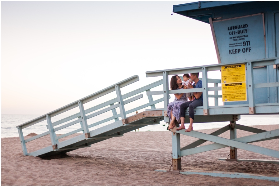 Baby with Family on Lifeguard Tower at the Beach by Just Maggie Photography - Los Angeles Baby Photographer