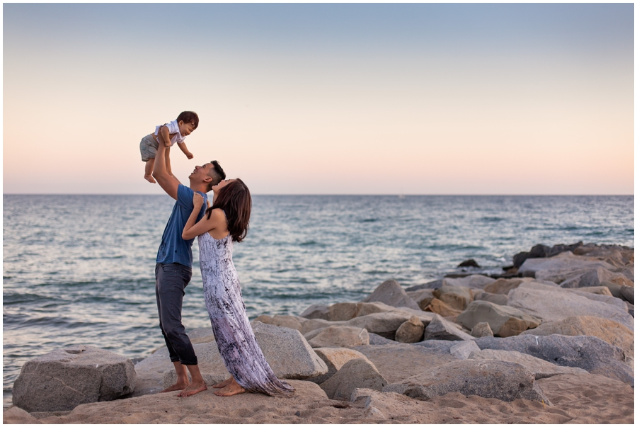 Baby with Family at Sunset at the Beach by Just Maggie Photography - Los Angeles Baby Photographer