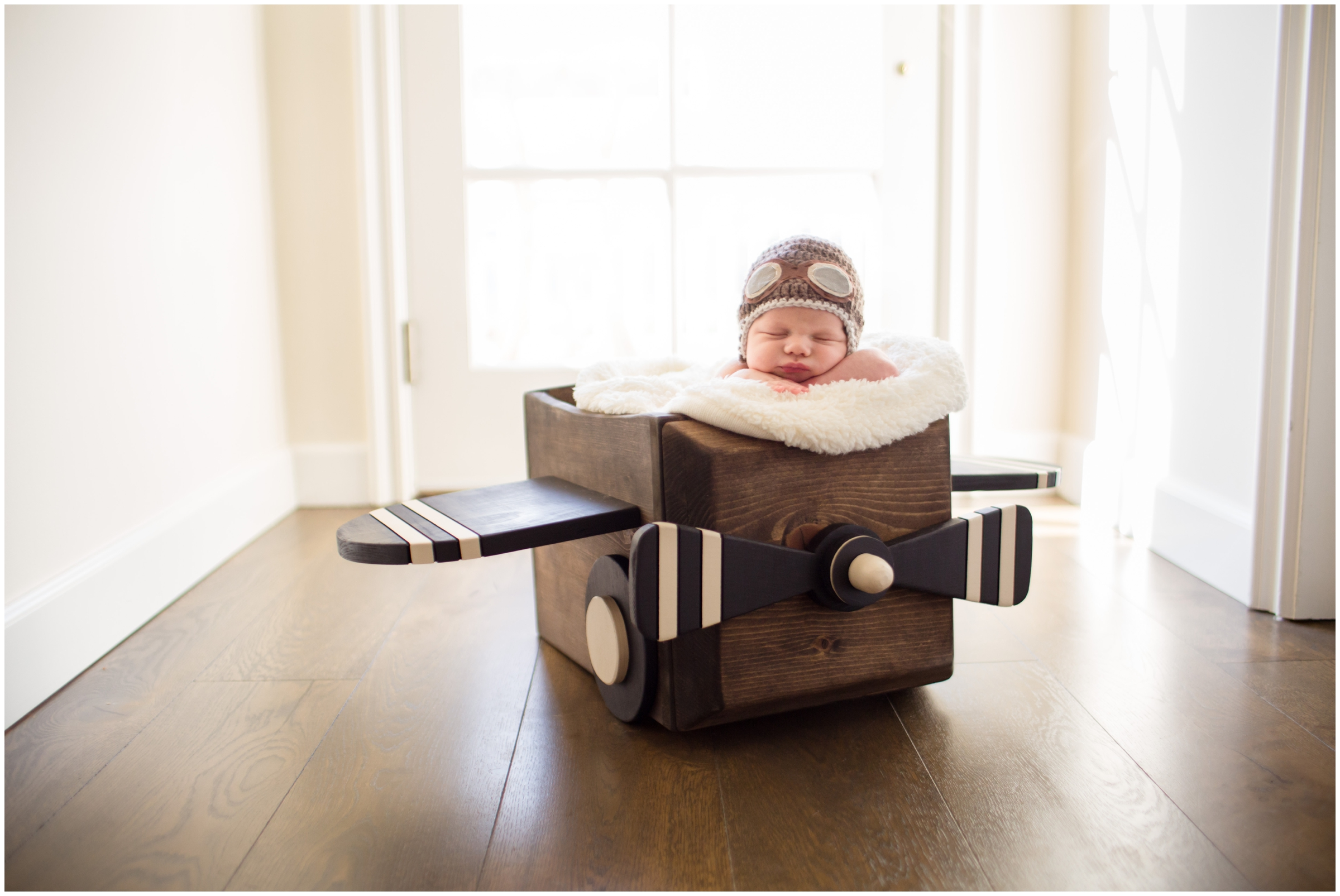 Newborn in Plane Prop by Just Maggie Photography - Los Angeles Newborn Photographer